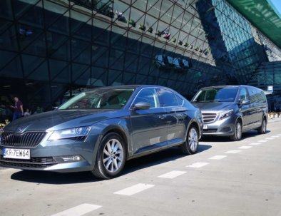 Skoda Superb and Mercedes Vito in front of Krakow Airport terminal
